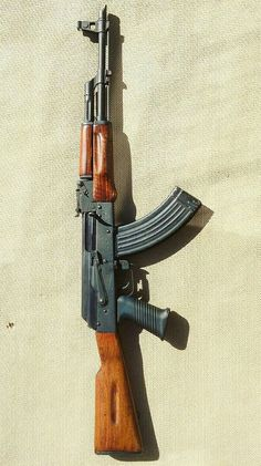 AK-47.The most reliable battle rifle ever invented. Every law abiding citizen needs one!!