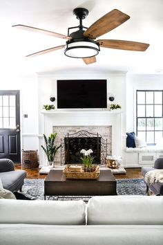 DIY Lime Washed Brick Fireplace | blesserhouse.com - A dirty and tired orange brick fireplace gets a brightened up, weathered lime washed brick makeover, plus a full tutorial to do it yourself. #livingroom