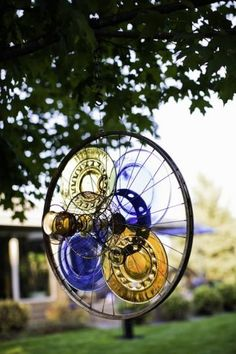 Manipulate an old bike tire and turn it into a yard decoration.