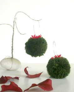 Mademoiselle pom-pom earrings in forest green and red.
