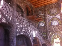Photo from a website with resources for earthship construction....wow what a room!! I bet it's amazing when the light hits it just right...or at night lit from inside.