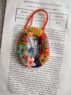 Gives me an idea for finishing off broken china brooches-not the style, just the idea. Julie Arkell.