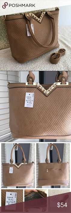 """🆕Brand New Tan Treasure handbag 👜 🔥Brand New Boutique Item (handbag)  ONLY 1 of this color and style available!👜 -Brand: sold by Karma&Cali (retails for $94) -Color: tan with gold hardware  -Dimensions: 13"""" length, 11"""" height, 5"""" width -Details: back pocket, interior pocket, two interior pouches, zipper closure, rhinestone """"v"""" design, optional crossbody strap -Other: creases iron out with use,lighting varies color/cannot be restocked/open to  •good o f f e r s• using Posh's offer button…"""