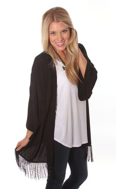ONLINE EXCLUSIVE! Throw on the Gatsby Dazzle Kimono for the perfect added touch to your outfit, with fringe and gold hemline details. Carly is wearing a size small and is 5'3″. Made of 100% polyester. #boutique #boutiqueclothing #clothingboutique #womensboutique