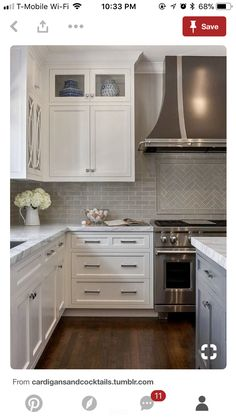 I like the contrast between the sideways backsplash and then the herringbone backspash behind the stove. Pretty flowers to soften the area. Like the different colored island.