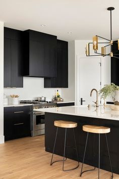 The white countertops paired with the penny-round tile backsplash makes for a perfect contrast with the kitchen's custom black stained cabinets and gold hardware. Black Kitchen Cabinets, Gold Kitchen, Black Kitchens, New Kitchen, Home Kitchens, Kitchen Decor, Kitchen Ideas, Kitchen Unit, Kitchen Black
