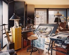 Midcentury Vintage Art Studio Work Space // An artist's studio with a pair of floor lamps and a mirrored folding screen; Lonny, Jeremiah Goodman