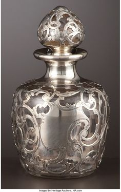 AN AMERICAN PERFUME BOTTLE WITH SILVER OVERLAY . | Lot #68320 | Heritage Auctions