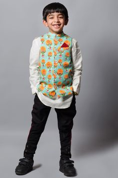 Kurta and Jeans  Most effortlessly suave and comfortable is to match it up with a simple long sleeve kurta and pair of his favorite denims. Another complementing way to pull this look is with classic shirt tucked out and denims. Push the fashion envelope by using these amusing printed Nehru jackets for kids.