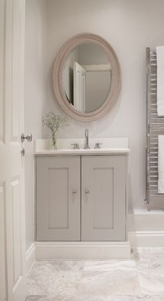 """nice soft grey - raised vanity with skirting in soft grey instead of home depot white - warm """"restoration hardware"""" browns and greys giving bathroom a warmer hue"""