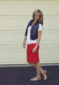 Simple and pretty: red skirt, white t-shirt, jean vest