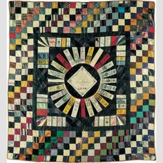 """OREGON PIONEER ORGANIZATION QUILT FOR EUDA ALETHA KELLY/ Eudoxia Aurora Kelly Niblin (1865–1945), Oregon,1923, silk with silk embroidery, 73 × 67 3/4"""" (framed), gift of Margaret Cavigga, collection of the American Folk Art Museum, New York, 1985.23.9. Photo credit: John Parnell."""