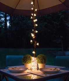 Backyard Patio Dining Umbrella Lights And Mason Jar Lights Centerpiece