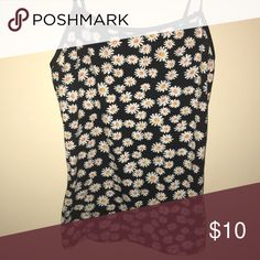 Daisys tank top It's a size Small and also Medium, it's a nice fabric. It fits well to your body since it's stretchy Tops Tank Tops