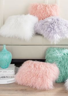 Exceptionally soft and dramatically gorgeous, our Mongolian Sheep Fur Pillow is the real thing, not faux. It's a bit of glamour for any space, with the fun pop of color serving as the unexpected twist.