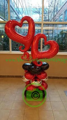 Festive abstract heart Columns perfect for Go Red, Valentine's or any other event expressing love. Red, silver or hot pink. The choice is yours. #abovetherestballoons  #abovetheresteventdesigns  #anagram  #amscam  #knoxvilletn  #tennovahospital  #gored  #balloonsknoxville  #ballooncolumn  #valentines #love