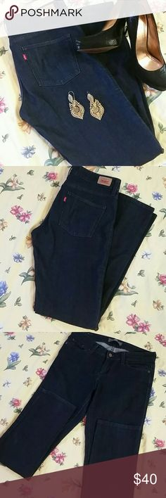 """*Final Price Drop* NWOT! Levi Straight - Stretchy NWOT! These are in new condition. Never worn. Only tried on a couple times. The dark wash is super crisp and deep. There is no rip, tear, or stain anywhere. Inseam 32 1/2"""" Thigh Opening 10 1/2"""" Rise 9"""" Waist Circ 31"""" Enjoy! Levi's Jeans Straight Leg"""