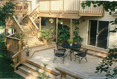 Find multi level decks design ideas to help you design and planning your custom multi level deck & beautify your backyard with this complete guide. Small Backyard Decks, Decks And Porches, Outside Living, Outdoor Living, Second Story Deck, Deck Framing, Tiered Deck, Deck Builders, Diy Deck
