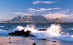 Table Mountain, South Africa Cape Town's flat-topped mountain has withstood six million years of erosion and hosts the richest, yet smallest floral kingdom on earth with over floral species. It also boasts numerous rare and endangered species. Table Mountain Cape Town, Le Cap, Cape Town South Africa, Seven Wonders, Africa Travel, Vacation Spots, Places To See, Beautiful Places, Around The Worlds