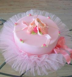 Ballerina Party ... love the tulle on bottom of a simple, tiered cake.