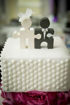 Small Polka Dot Wedding Cake with Puzzle Piece Cake Topper | Brett Matthews Photography https://www.theknot.com/marketplace/brett-matthews-photography-roslyn-heights-ny-293166