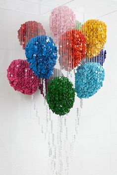 Artist Augusto Esquivel realistically duplicates objects by suspending thousands of sewing buttons on mere strings. Each strand of his incredible sculptural pieces work with their adjacent string of buttons to create colourful replicas of everything, from a basic geometric cube to a stone fountain covered in flowers and spouting water,