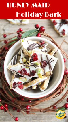 This festive holiday bark is easy to make using HONEY MAID Grahams! Melt white chocolate wafers in a microwave safe bowl and pour the white chocolate over HONEY MAID Grahams. Sprinkle dried cranberries & pistachios on top. Melt dark or milk chocolate, put into a zipper bag and snip the corner. Drizzle over the bark. Allow bark to cool and break into pieces. It's delicious and perfect for parties and holiday gift giving!