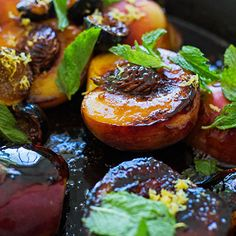 caramelize peaches over an open fire. With figs, amaretto and mint
