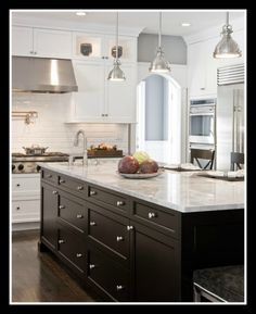 Black island and white cabinets. No joke this is what my new neighbor's house looks like. Pendant lights and all!