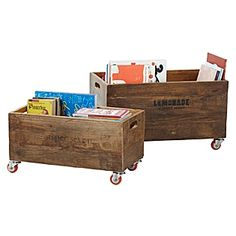 storage idea for under garage shelves. Use wood wine boxes. Attach wheels to roll them out as needed.