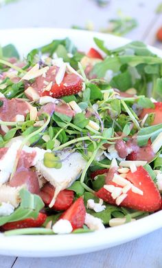 Strawberry Arugula Salad with Goat Cheese and Chicken.