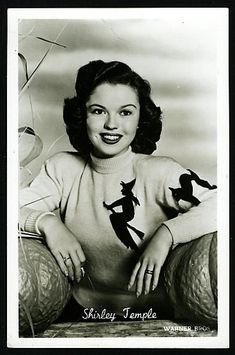 A sophisticated Shirley Temple in a nice Halloween sweater