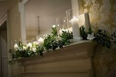 decorating a fireplace mantel.  Pretty for spring or summer,  even winter.  Soft and elegant.  Will consider this for front room fireplace.