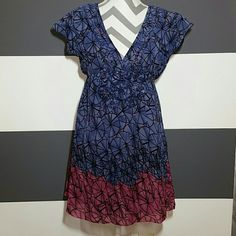 """🆕🚲Bicycle print Dress NWOT Brand new no tags  Super playful and fun empire waist style dress. Cute bicycle wheels print and adorable flower details under the bust. Cinches at waist with elastic. Classy pleated details on each side of the neckline. Colors of magenta and purplish blue and black print.   Top layer is sheer and inside has blue lining Shell 100% polyester, lining 80% polyester 20% polyamide  size small Length approx 31"""" Bust approx 16""""   💗Price is firm 💗No trades Dresses Mini"""