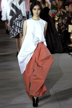 Not fond of styles that are just masses of volume. The body has to be under there, somewhere. John Galliano.