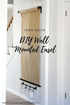 DIY Wall mounted Easel. Ikea hack done on a budget so your kids can enjoy an easel while still keeping your home stylish. #ikeahack #DIY #arteasel #diyhomedecor #homedecor