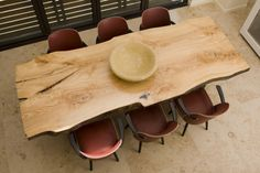I love the idea of using a big slab of reclaimed wood with live edges and pairing it with modern chairs.