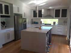 White Kitchen! Stone bench top loveee. Island bench, fixed glass and gas stove