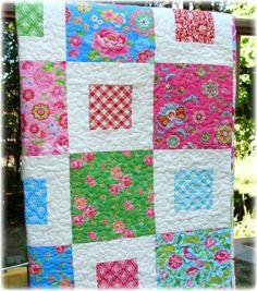 baby quilt - solid blocks w/white lattice around center squares