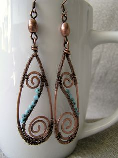 http://wiremoon.co.uk/wp-content/uploads/2011/05/Wire-wrapped-copper-earings-blue.jpg