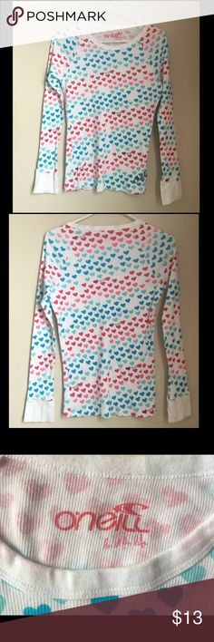 "O'Neill Long Sleeve Shirt O'Neill Long Sleeve Shirt • White with hearts • Hearts are shades of blue and pink  • 100% cotton • Size medium • 22"" sleeves • 25"" long O'Neill Tops"