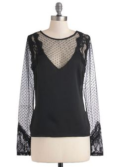 black satin intersected with Swiss-dotted, lace-trimmed sheer mesh at the V-cut illusion neckline, sleeves, and back