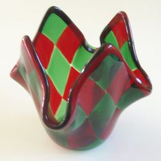 This versatile little dish makes a great votive candleholder or catch-all. The red and green are so festive, it really puts you in the Christmas spirit! It measures approx. 5 inches wide by 4 inches high. This item was fired twice in the kiln for many, many hours and has been carefully and properly annealed.