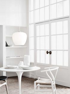 Crisp, white Wegner Wishbone + Saarinen Dining Table. Maybe with a pop of purple.