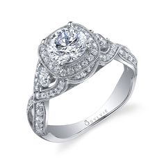 Style# S1015S Bold Criss-Cross Round Diamond Engagement Ring - This glamorous white gold diamond engagement ring features a 1 carat round brilliant center in a feminine crisscross design with a total of 0.84 carats. https://www.sylviecollection.com/bold-criss-cross-round-diamond-engagement-ring-sy1015s