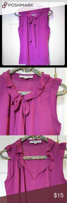 Loft ruffle collar sleeveless blouse size S Purple sleeveless Loft blouse with ruffle collar, ruffle cap sleeve, tie neckline. Size small. Never worn. Great match for the Liz Claiborne skirt I'm also selling--bundle and save! 100% polyester, easy care. Great under blazer for a pop of color! Smoke free home. LOFT Tops Blouses