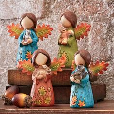 Fall Decor - Each hand-painted angel is holding a different forrest friend: raccoon, squirrel, rabbit and hedgehog. Come Home to Comfortable Living Through the Country Door! Diy Fairy Door, Pottery Angels, Clay Angel, Pottery Painting Designs, Handmade Angels, Ceramic Angels, Cold Porcelain, Bottle Crafts, Clay Art