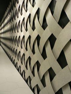 basket weave wood or metal flashing & have lighting on frame  20m wall of slim porcelain tile
