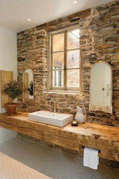 rustic bathroom ideas stone wall solid wood vanity white sink recessed lighting