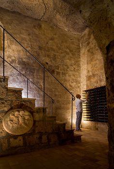 May 2013 Issue - A staircase leading to a wine cellar located in a cave